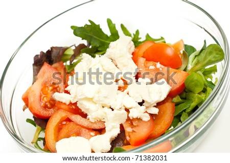 freshly made salad isolated on white background