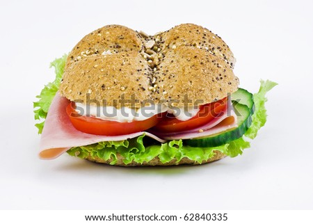 Freshly made sandwich with ham and vegetables - isolated