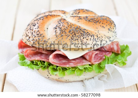 Freshly made sandwich with salami and cheese