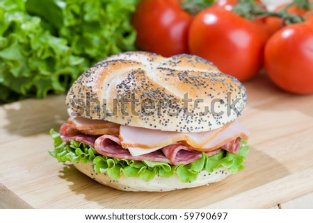 Freshly made sanwich on wooden cutting board