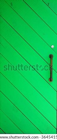 Freshly painted rustic wooden door - closeup