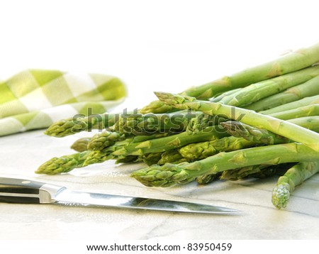 Freshly picked asparagus on white marble cutting board