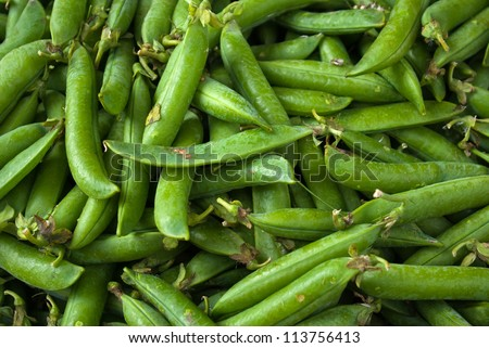 Freshly picked healthy green peas beans in a vegetables shop - stock photo