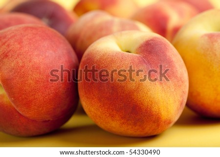 Freshly Picked Peaches On A Yellow Background