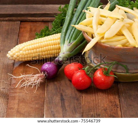 Freshly Picked Vegetables on Rustic Wood Background with copyspace or room for your text or words - stock photo