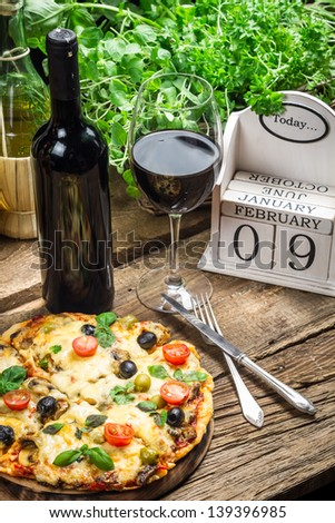 Freshly pizza served with red wine