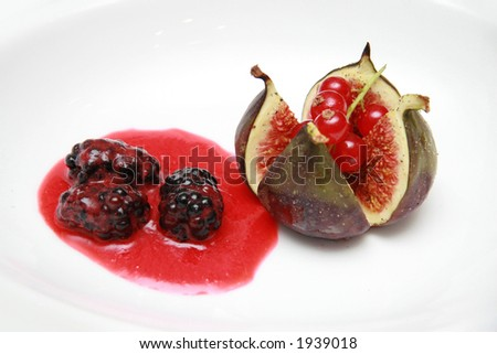 Freshly poached fig with mulberry fruit and sauce appetizer course