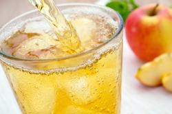 Freshly poured apple juice spritzer