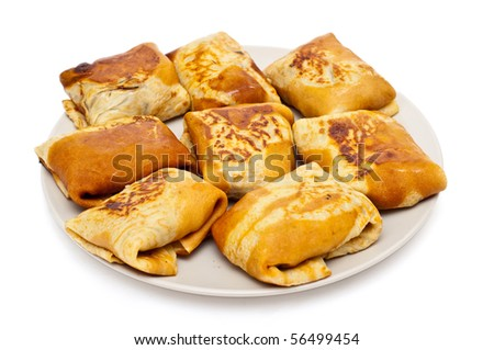 freshly prepared pancakes with meat - stock photo
