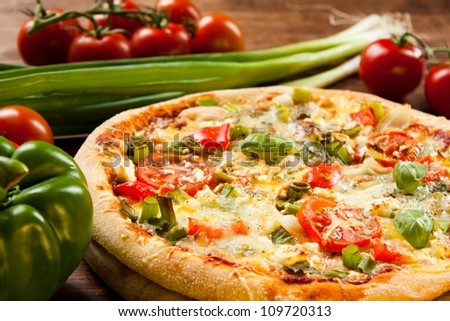 freshly prepared pizza, baked with herbs and vegetables