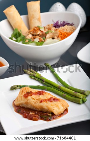 Freshly prepared Thai style sea bass fish dinner with asparagus and appetizer with a contemporary presentation.