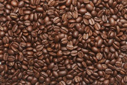 Freshly roasted coffee beans background