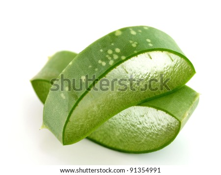 Freshly sliced Aloe Vera showing green skin and juicy texture, on white background. Fresh Aloe Vera is natural remedy for sunburn relief and cure many things