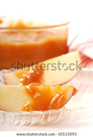 Freshly sliced apples with a caramel dipping sauce drizzled on them - stock photo