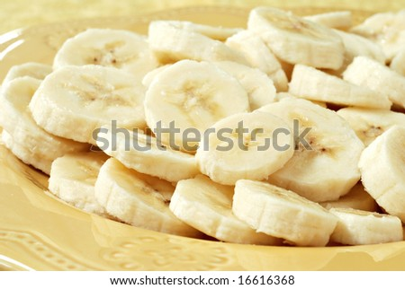 Freshly sliced bananas on a decorative plate.  Macro with shallow dof. - stock photo