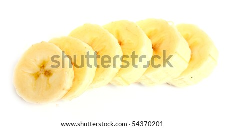 Freshly sliced bananas on a white background. Macro with shallow dof. - stock photo