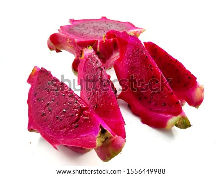 Freshly sliced red dragon fruit isolated from a white background. Helpful Stamina, Lowering Cholesterol Levels, Helps Healing Cancer, Reduces High Blood Pressure, Prevents Osteoporosis.