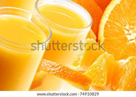 Freshly squeezed orange juice montage.