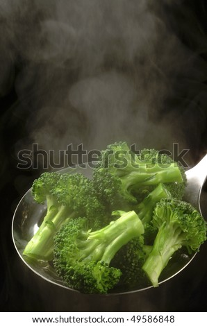 freshly steamed broccoli in skimmer