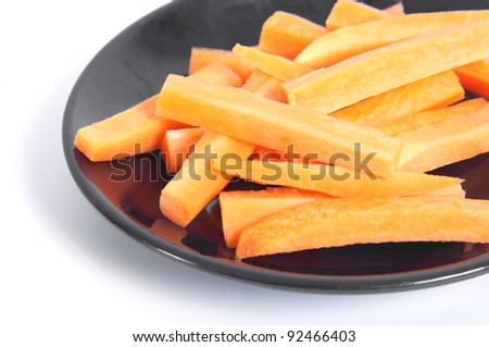 Freshness carrot in thin slices on dish