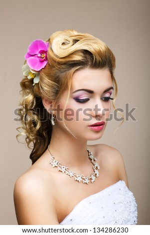 Freshness. Femininity. Beauty Portrait of Classy Woman with Flowers. Dreaminess