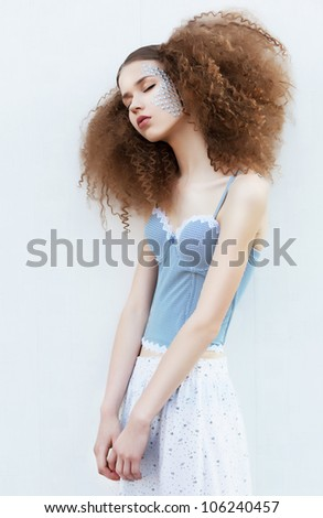 Freshness. Healthy young gentle woman isolated on white background. Curly hairs