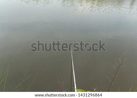 Freshwater angling with rods beside a lake, Azerbaijan - Astara