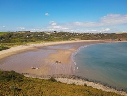 Freshwater East Beach in Pembrokeshire, Wales UK, is a stunning coastal location that has amazing ocean waters and attracts many tourists to its shores!