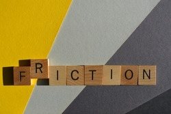 Friction, Fiction, word in wooden alphabet letters isolated on grey and yellow background with copy space
