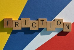 Friction, word in wooden alphabet letters isolated on multi coloured background