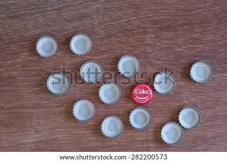 Friday, 29 May 2015: in Chiang Mai Thailand ,Coca Cola Bottle Caps on wood table.