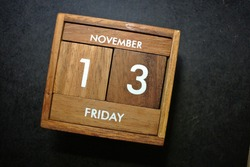 Friday 13th, November on wooden calendar. bad luck, Misfortune Day, Halloween Concept.