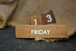 Friday 13th on wooden calendar. bad luck, Misfortune Day, Halloween Concept.