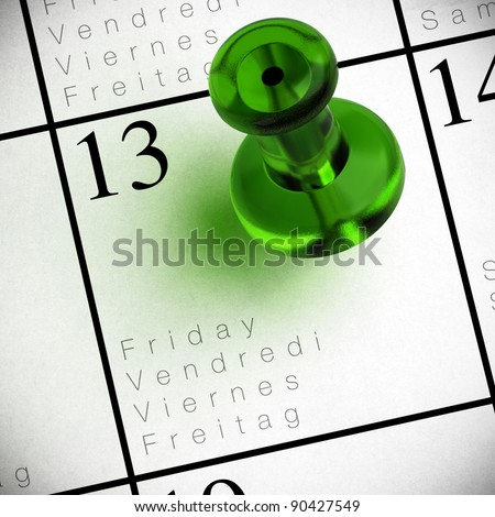 friday the 13th written onto a multilingual calendar with a red thumbtack with transparency