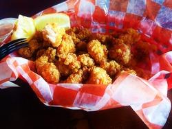 Fried Alligator Ribs serving basket with lemon at the Everglades Florida