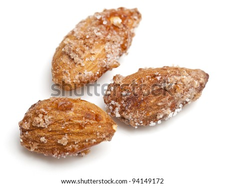 fried almonds with sugar and cinnamon isolated on white background