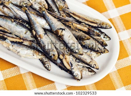 Fried anchovies on a plate (shallow dof)