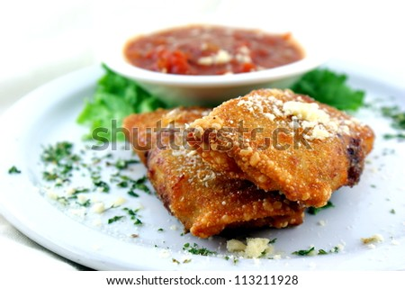 Fried Appetizer - Crumbled Italian sausage combined with three-cheese mixture then wrapped in egg rolls and fried to a crispy texture.