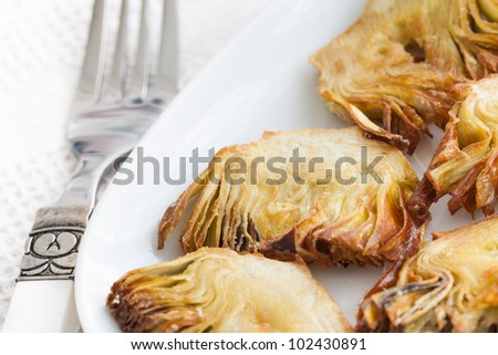 Fried artichoke tapas with white background.