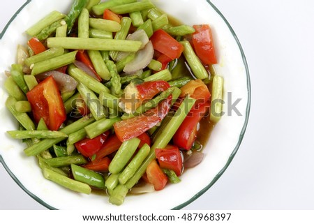 Fried asparagus with capsicum isolated on white. #487968397