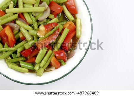 Fried asparagus with capsicum isolated on white. #487968409