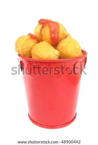 Fried balls with tomato ketchup
