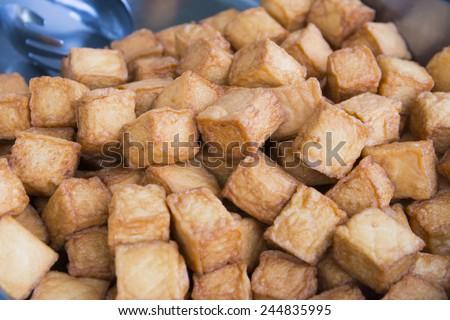 fried bean curd eaten with sauce