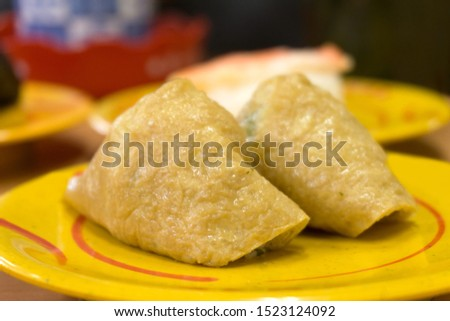 fried bean curd stuffed with boiled rice.japanese sushi