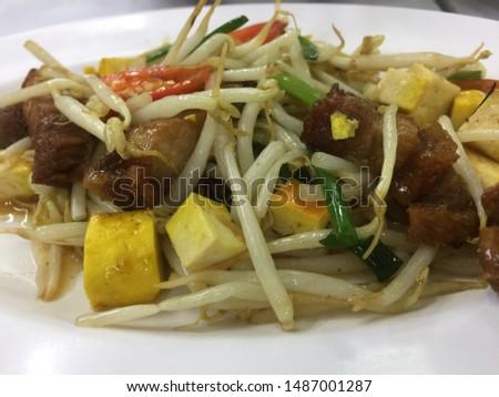 Fried bean sprouts, tofu, crispy pork