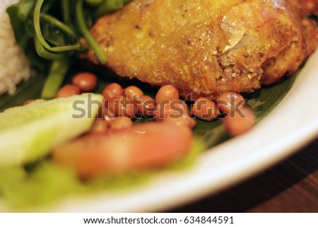 Fried beans, fried chicken with typical Indonesian vegetables