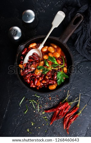 fried beans in metal pan, fried beans with tomato sauce