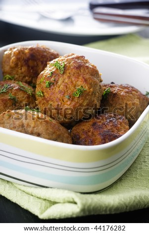 Fried beef cutlets with dill and mushrooms in a bowl