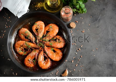 Fried big shrimps in tomato sauce with olive oil, garlic, cilantro and soy sauce...
