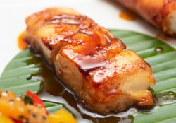Fried black cod with soy sauce and banana leaf - asian style
